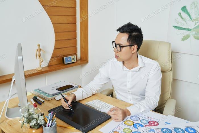 Graphic Designer in Drawing Logotype