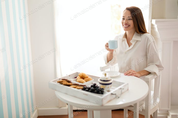 Beautiful woman enjoying morning tea