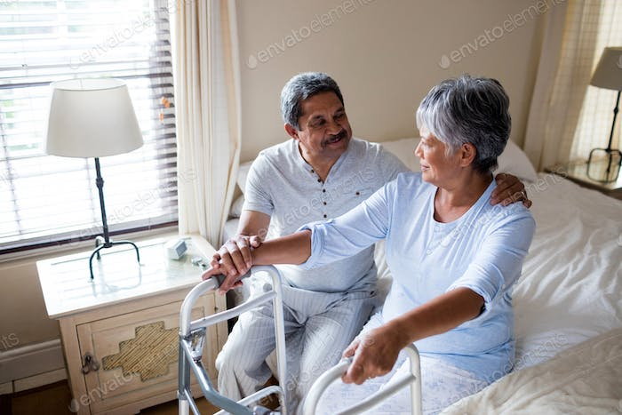 Senior couple interacting with each other on bed