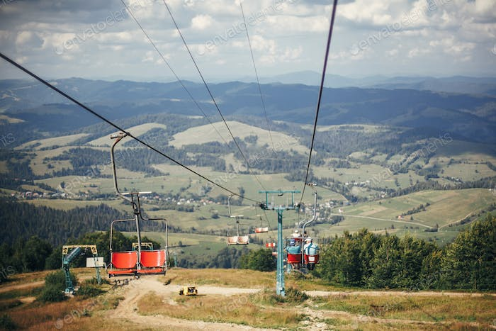 Old chair lift hoist and beautiful landscape of mountains hill