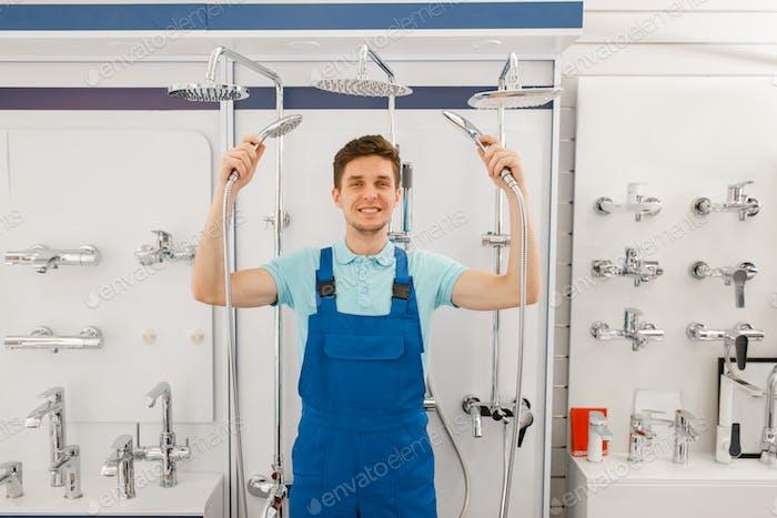 Plumber choosing shower in plumbering store