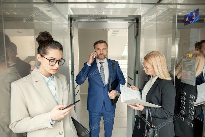 Business people standing in elevator