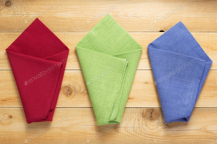 cloth napkin on at rustic wooden plank background