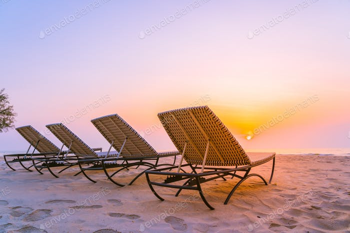 Empty chair on the tropical nature beach and ocean sea at sunris