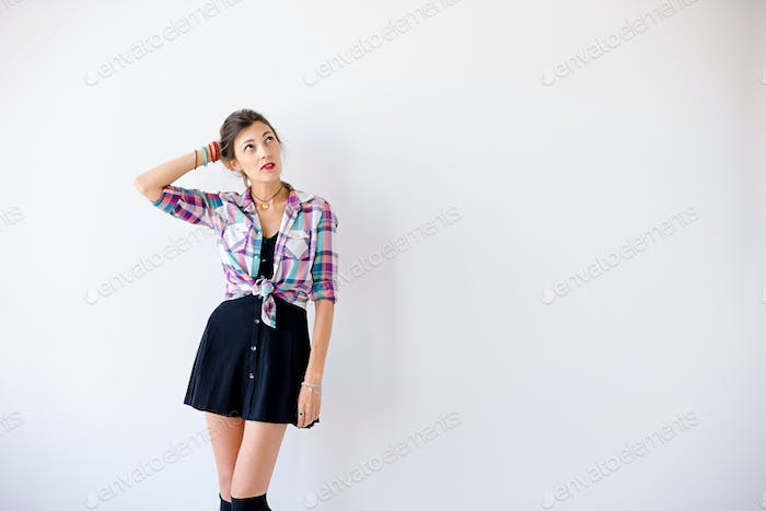 Hipster girl worried what to dress to the party