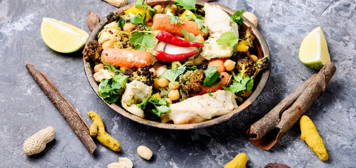 Chicken with vegetables and chickpeas in Indian