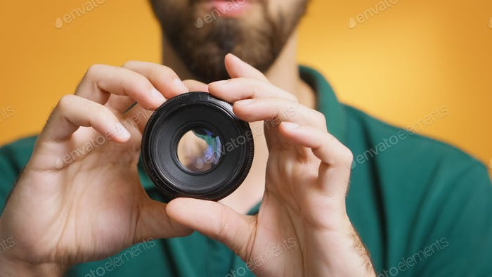 Content creator testing camera lens