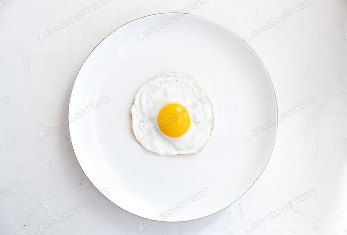 Fried egg isolated on white background, top view