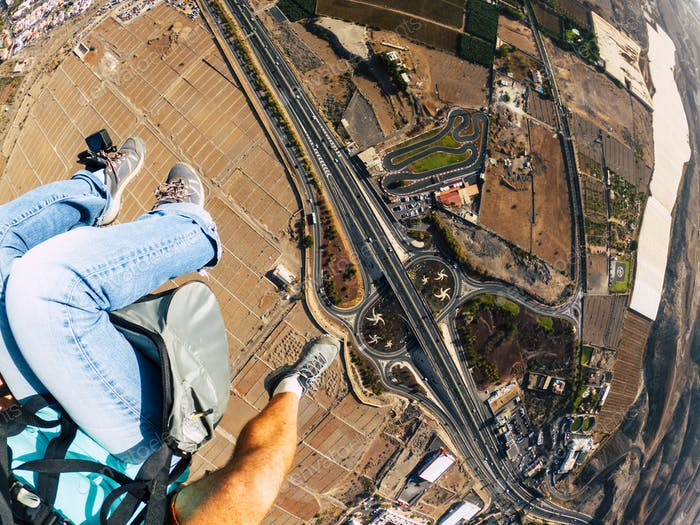 Air view of people couple doing paraglyde adrenaline activity