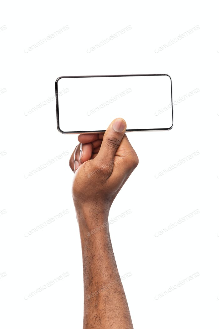 Smartphone with blank screen in horizontal orientation in man's hands