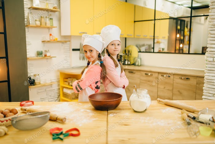 Girls cooks in caps are back to each other