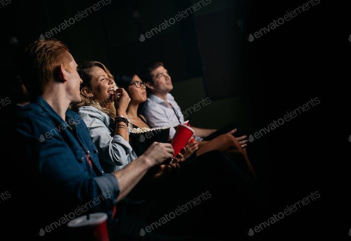 Group of people watching movie in cinema