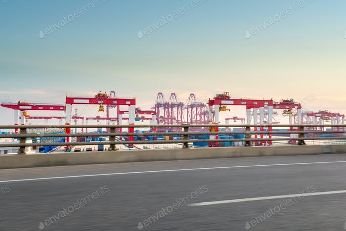 Thumbnail for container port with road at dusk
