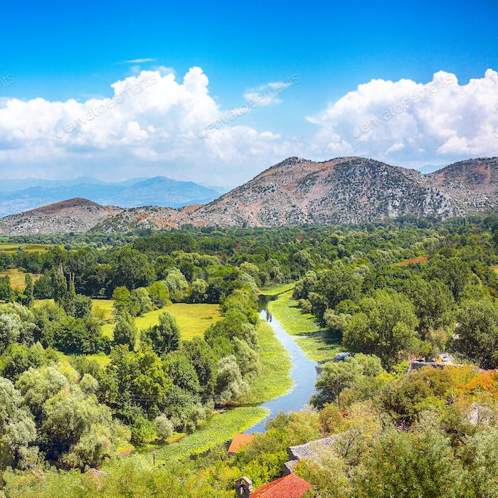 Aerial sunny morning view of valley of Moraca river from Zabljak Crnojevica Fortress