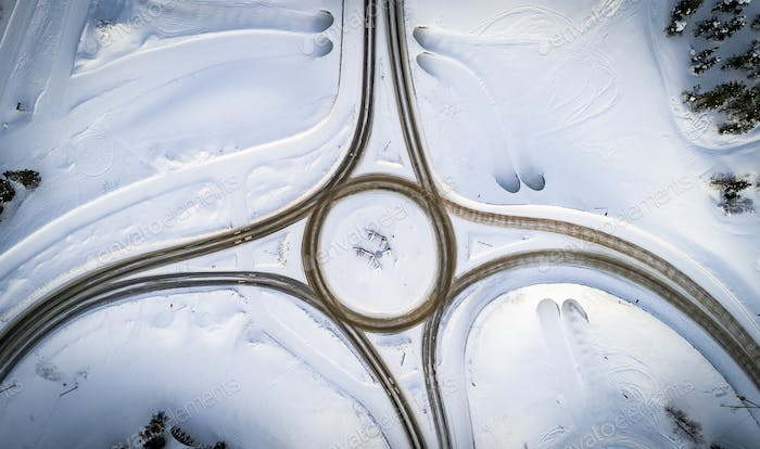 Aerial top view of country road junction in winter time