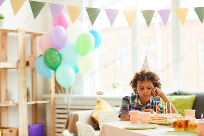 Sad Boy at Birthday Party