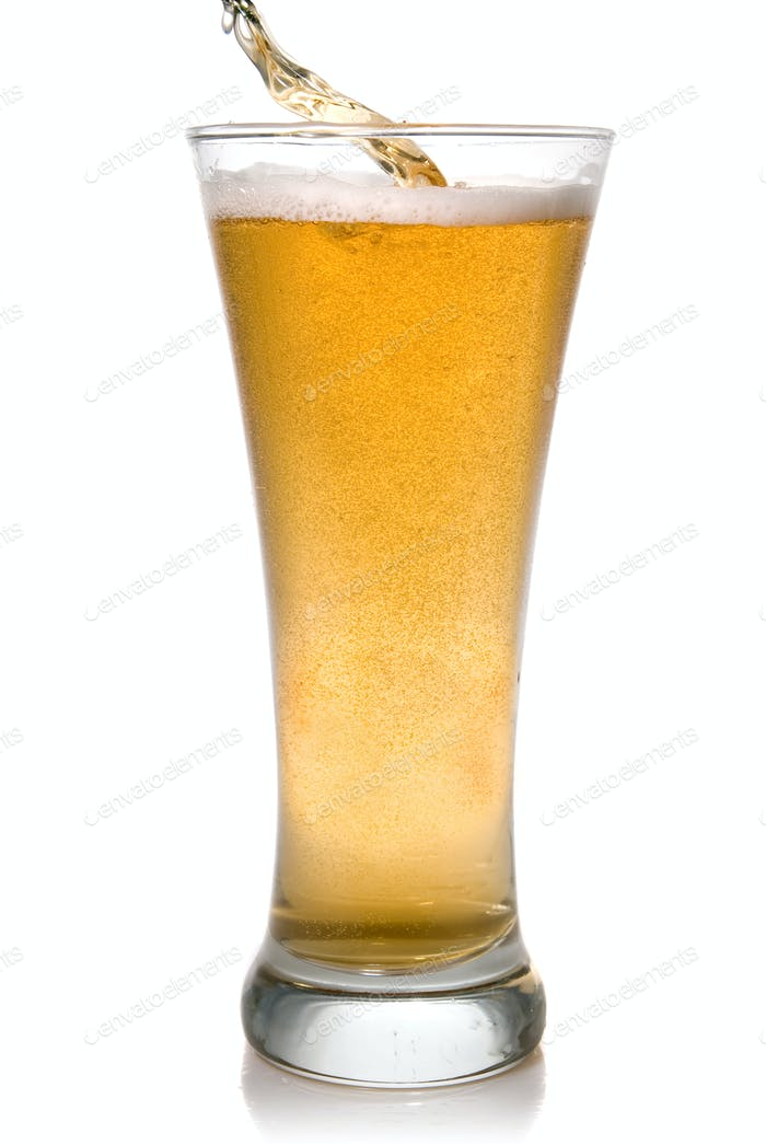 Beer pouring into glass isolated on white