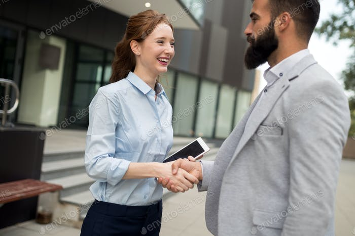 Business and office concept. Businessman and businesswoman shaking hands
