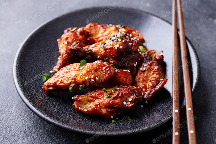 Chicken wings. Traditional asian recipe. Dark background. Close up.