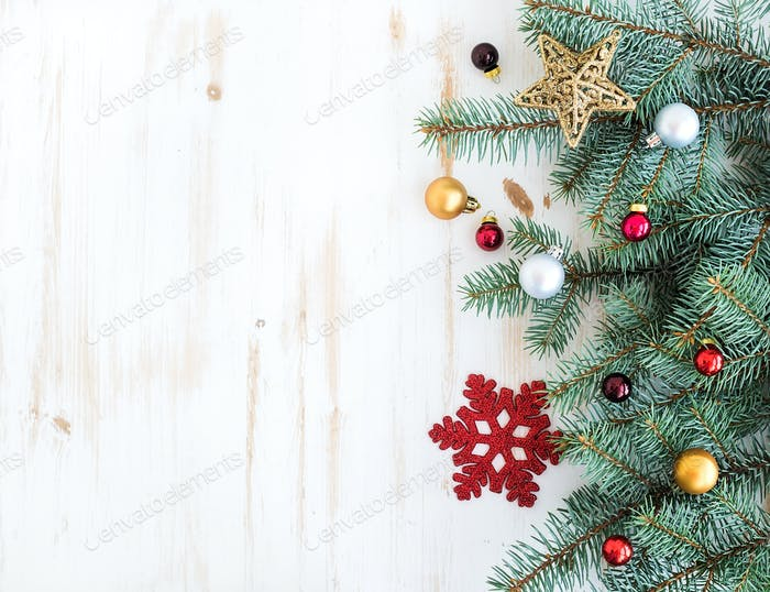 Christmas or New Year decoration background: fur-tree branches, colorful glass balls