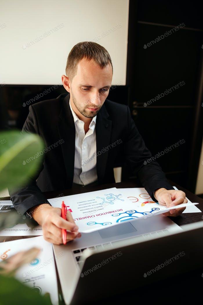 marketing product manager holding marketing promotion plan marketing product manager desk.