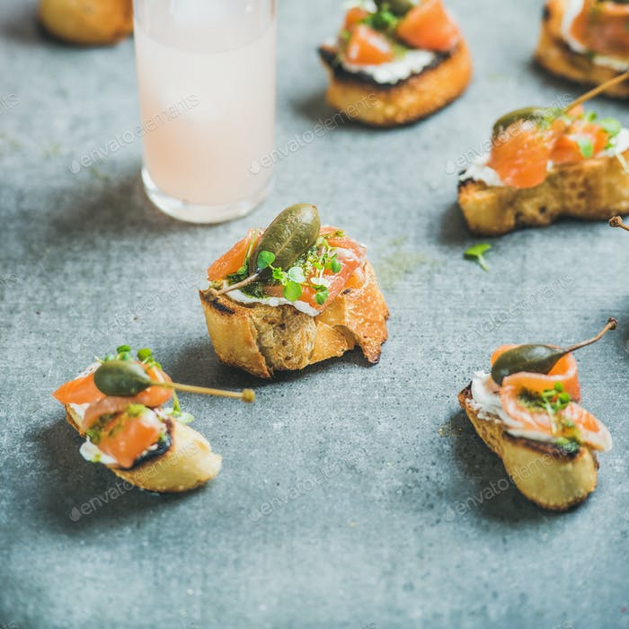 Crostini with smoked salmon and grapefruit cocktails, square crop