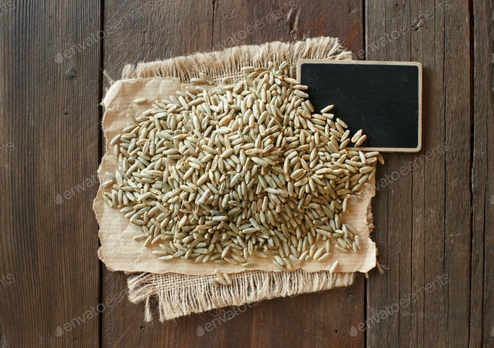 Pile of Dry Raw Rye Grain with a small chalkboard