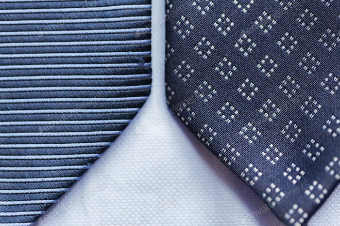 close up of blue patterned ties