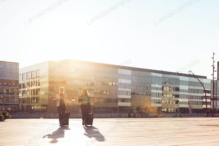 Businesswomen walking on sunny day