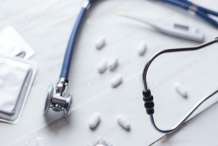 Antibiotics concept. Stethoscope with flu antibiotic on white table
