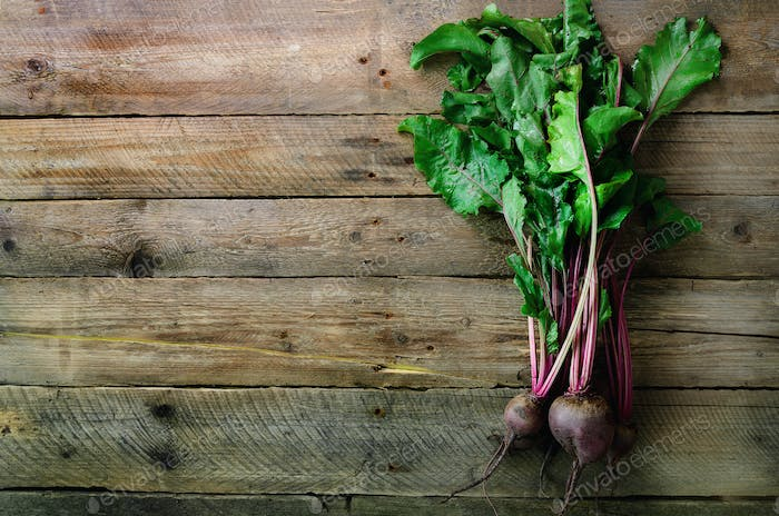 Bunch of fresh organic beetroot on wooden background. Concept of diet, raw, vegetarian meal. Farm