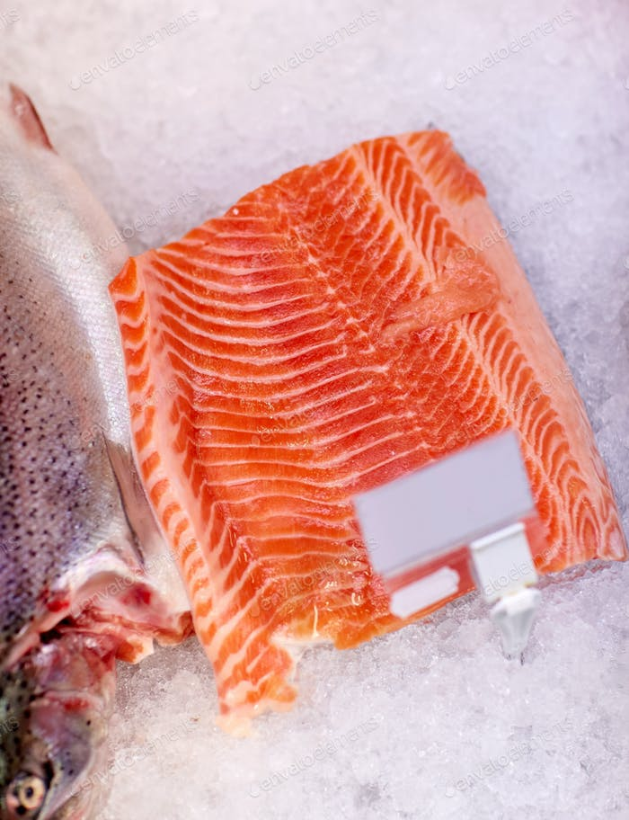 salmon fish fillet on ice at grocery