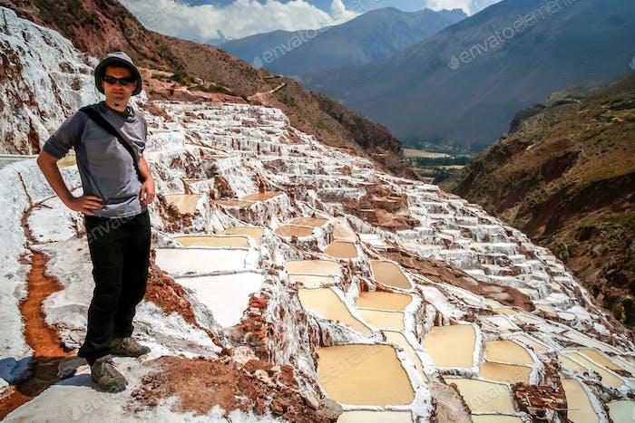 Tourist in the Maras salt mine in Peru