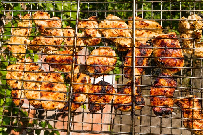 Delicious chicken on the grill.