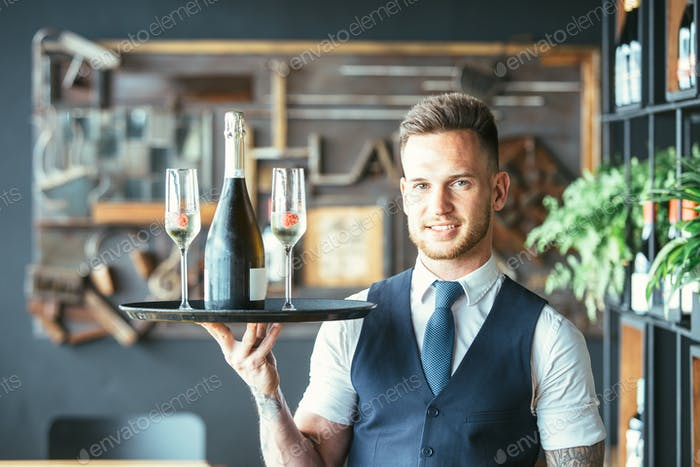 Smiling waiter with glasses