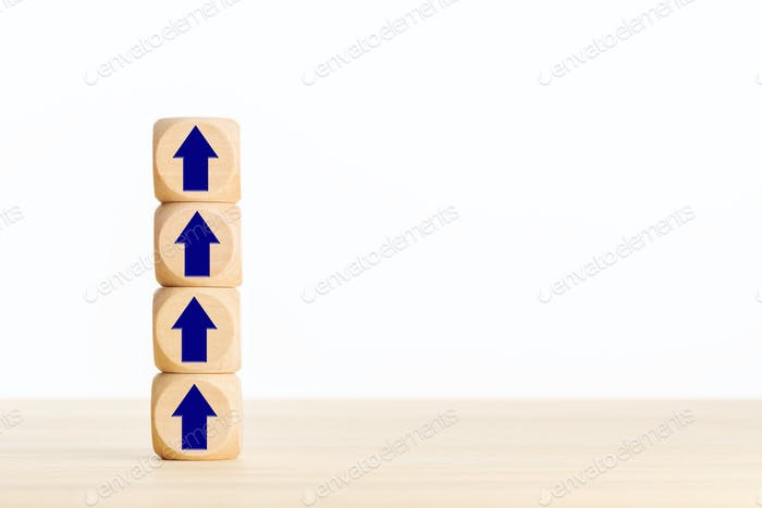 Pile of wooden blocks with Arrow pointing up