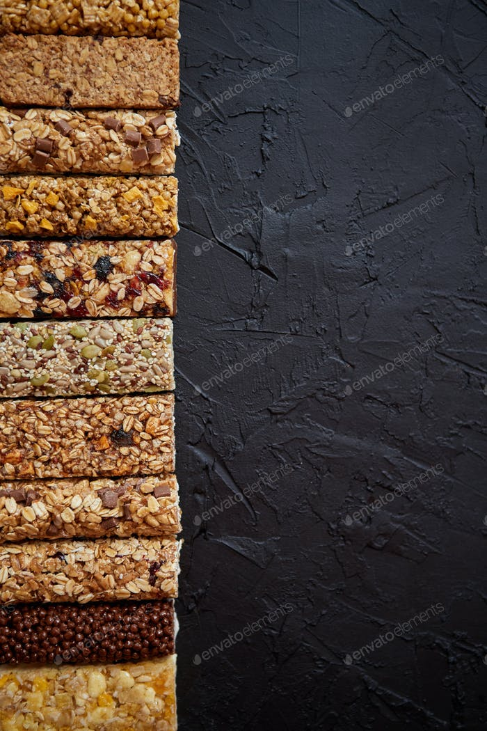 Row of mixed gluten free granola cereal energy bars. With dried fruits and nuts