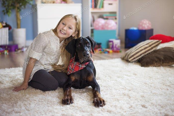 Cute girl posing with her cute pet