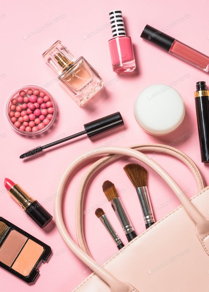 Woman flat lay makup background with cosmetics on pink