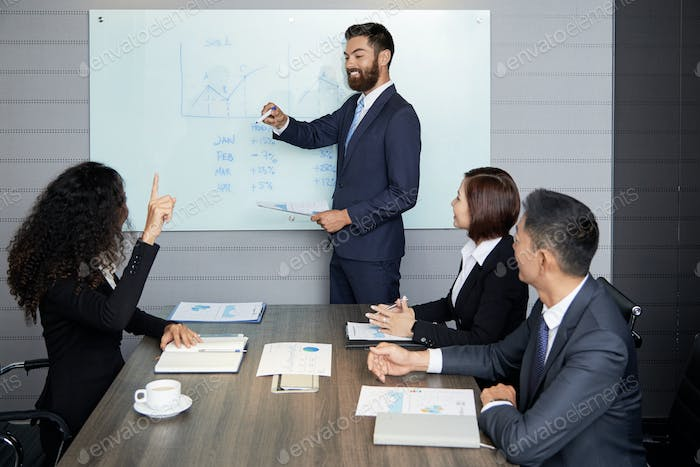 Businesspeople having meeting in conference hall