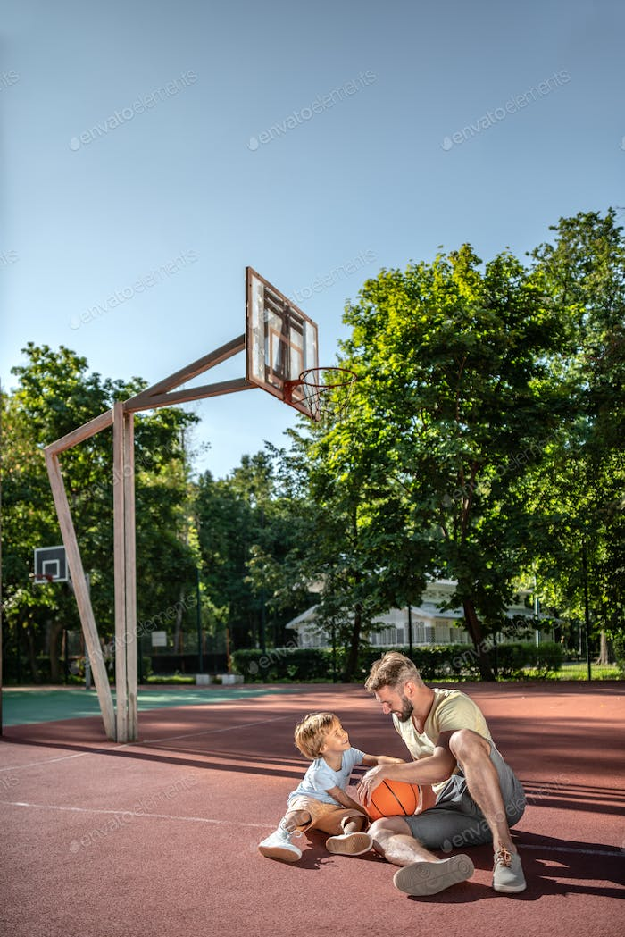 Father and son on the basketball court