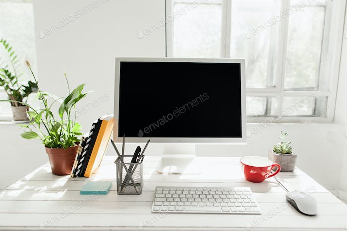 Stylish workspace with computer at home or studio