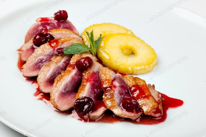 grilled duck meat with cherry sauce