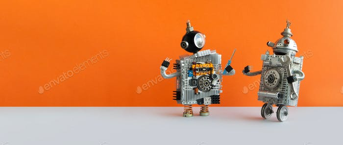 Two mechanical steampunk toys on orange background.