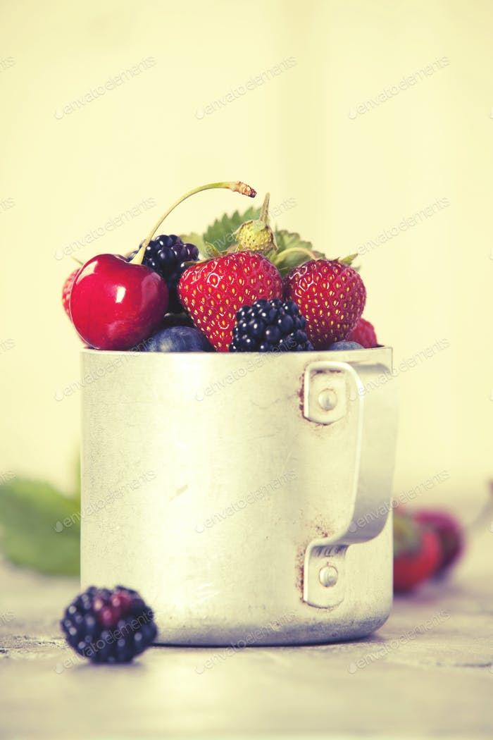 Berries in a rustic mug