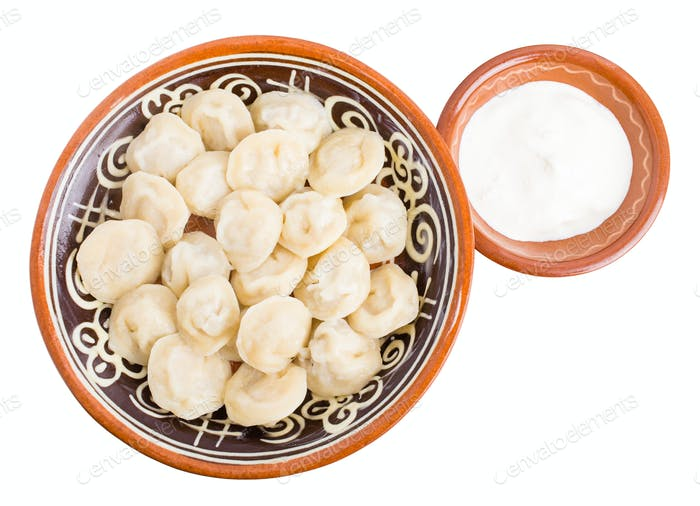 Russian dumplings pelmeni with minced beef meat.