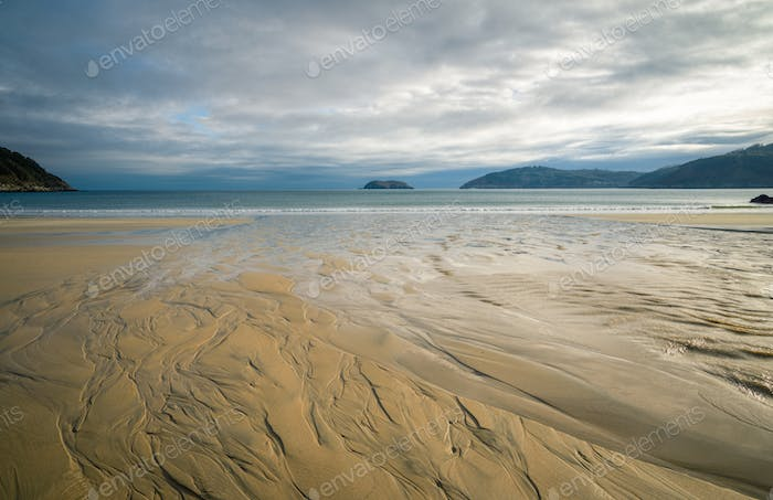 Patterns created by the ebb tide on a beach