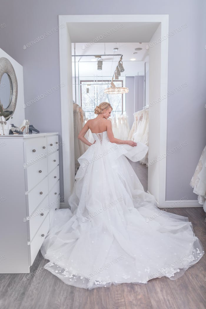 Beautiful bride in wedding shop