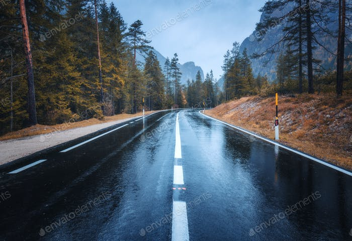 Perfect asphalt mountain road in overcast rainy day in Dolomites