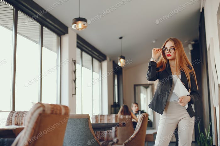 Stylish businesswoman in a cafe